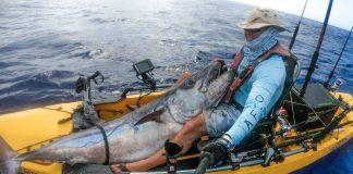 Kayak fisherman Raf Vargas showing his record breaking dogtooth tuna