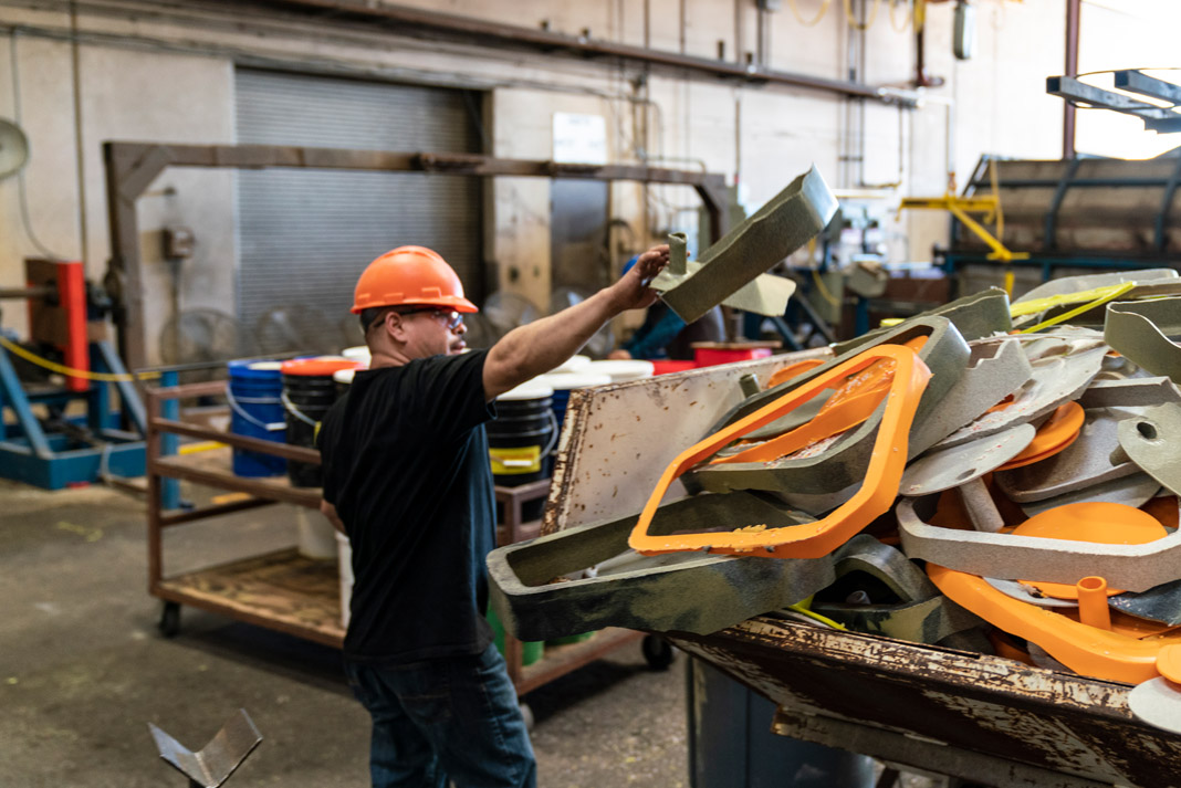 man re-using plastic for new kayaks