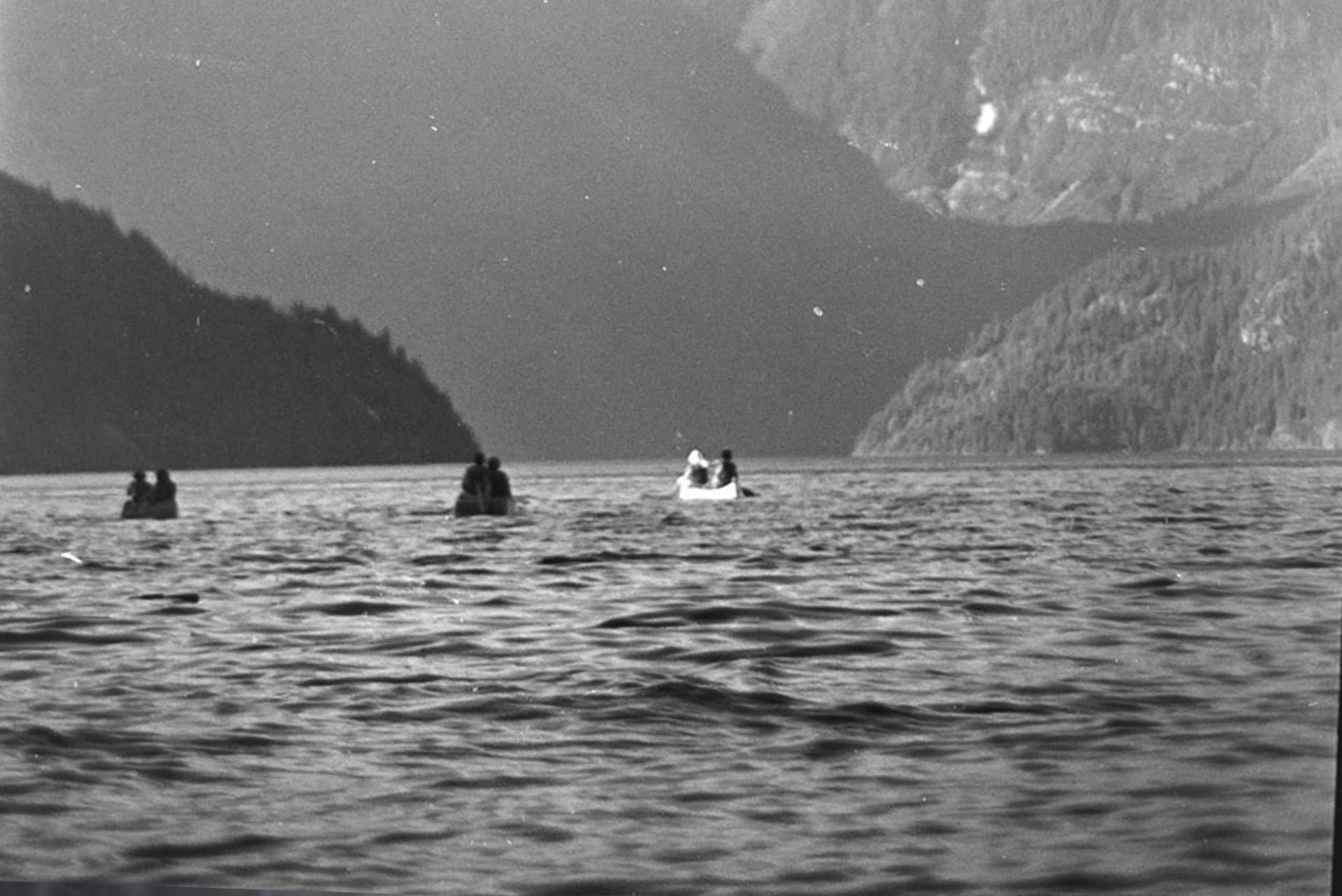 3 canoes paddle the inside passage