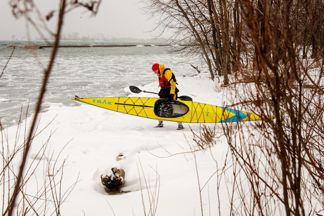 Trak Kayaks 2.0 Touring Kayak - Folding Kayak Review - Man launching foldable kayak into Lake Ontario, Canada