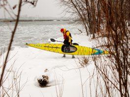 Trak Kayaks 2.0 Touring Kayak - Folding Kayak Review - Man launching foldable kayak into Lake Ontario, Canada