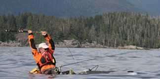man catches ling cod from a motorized kayak with Helix MD motor drive