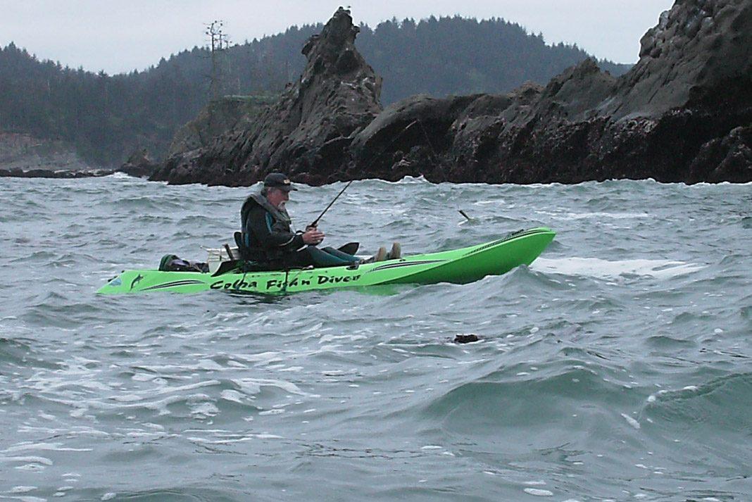 man fishing in green cobra kayaks fishing kayak