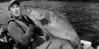 Angler Morgan Promnitz holding a large fish in a kayak