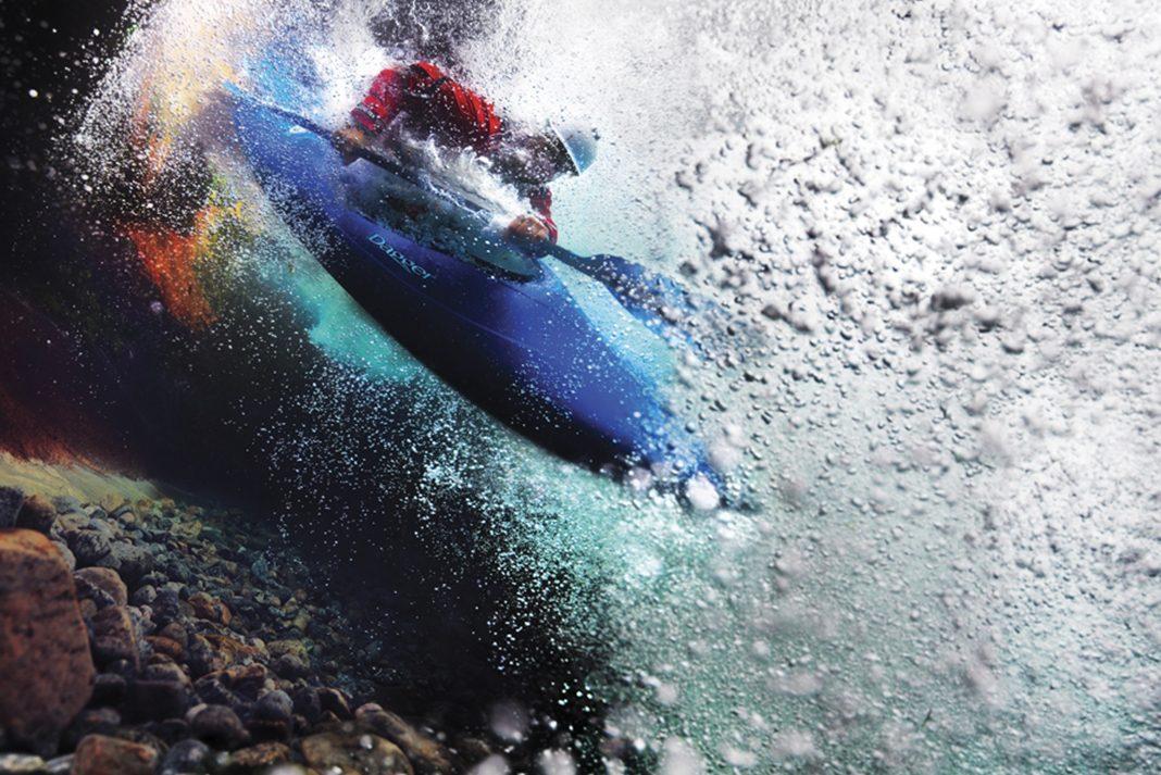 Photo of Kayakers landing in water below the surface