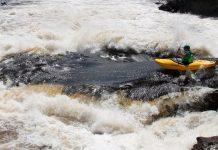Kayaker Graham Kent going through whitewater in Liquidlogic Kayak's Delta V 88 whitewater kayak