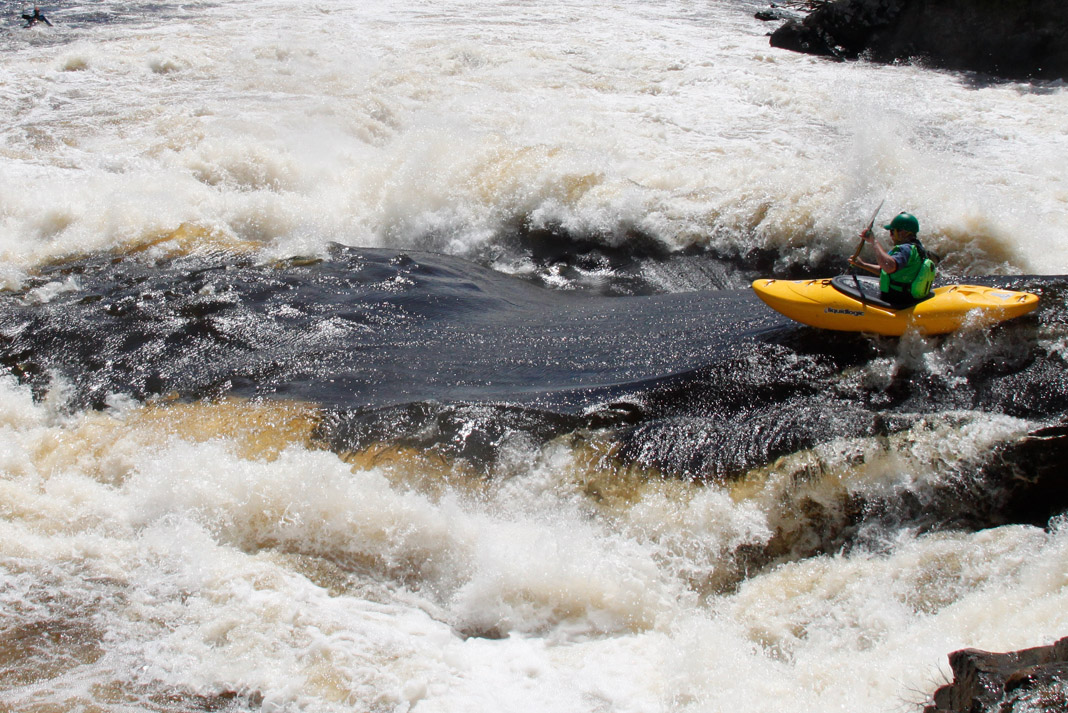 Kayaker Graham Kent going through whitewater in Liquidlogic Kayak's Delta V 88 whitewater kayak