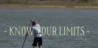 man paddling on a lake with the words know your limits across the photo