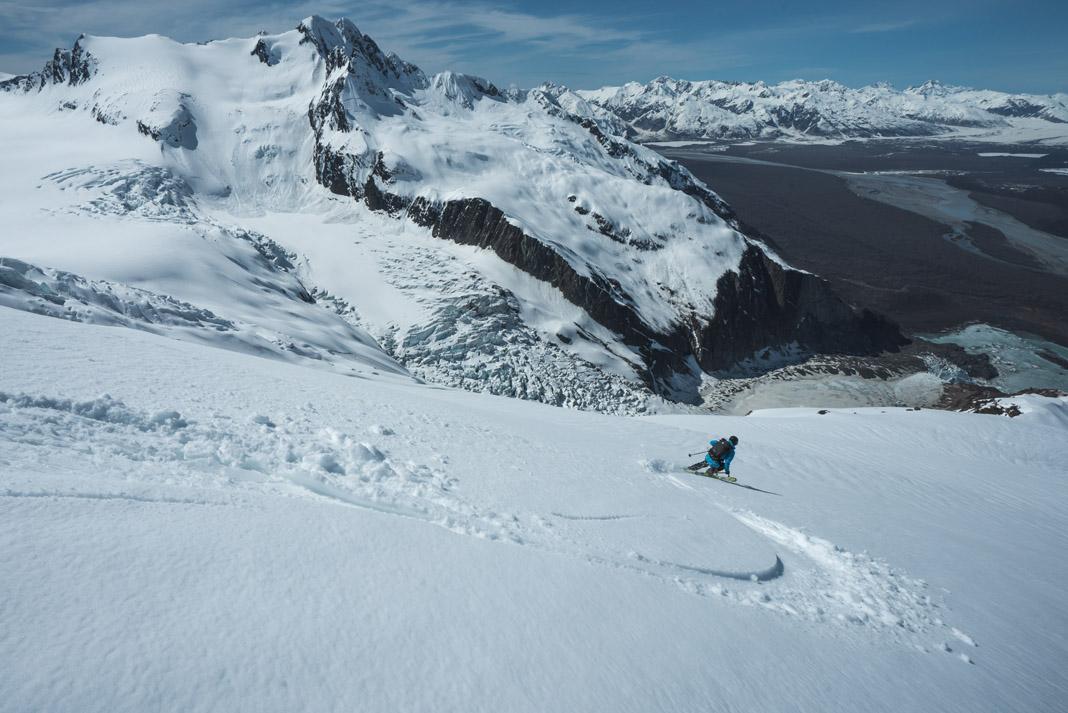 person skiing down a glacier in the Yukon