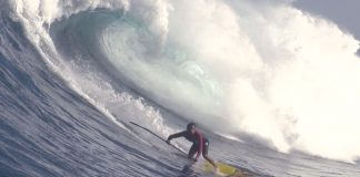 SUP surfer on a large wave