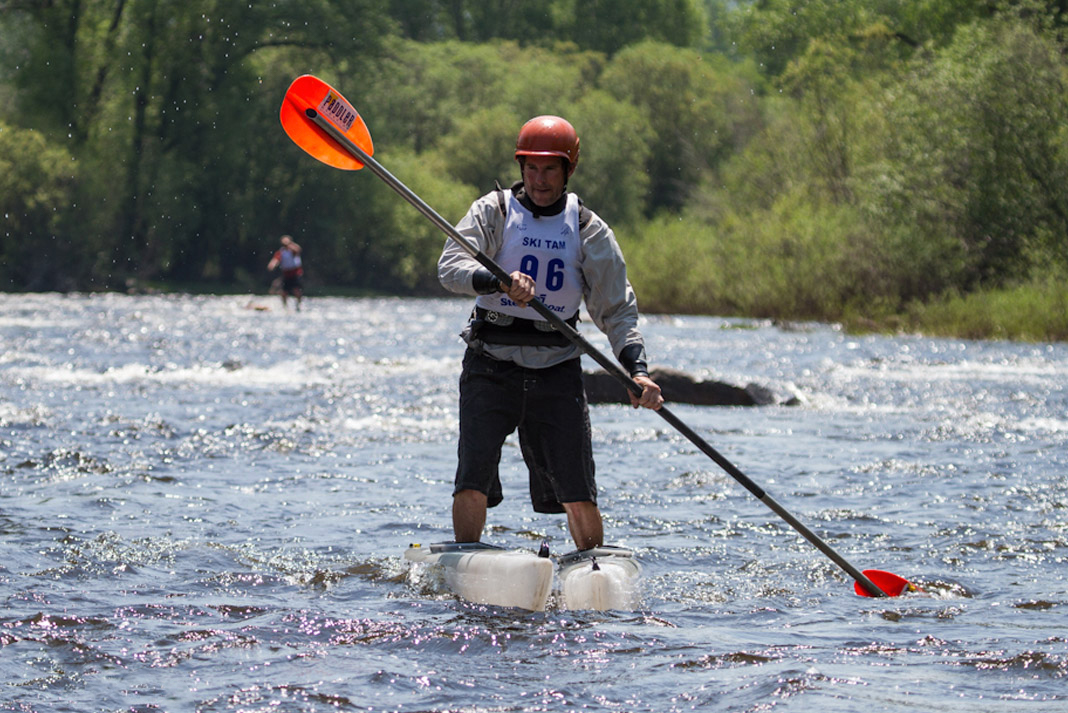 whitewater paddler using a skijak