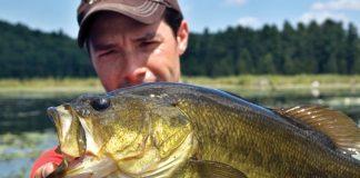 Kayak angler holding a bass