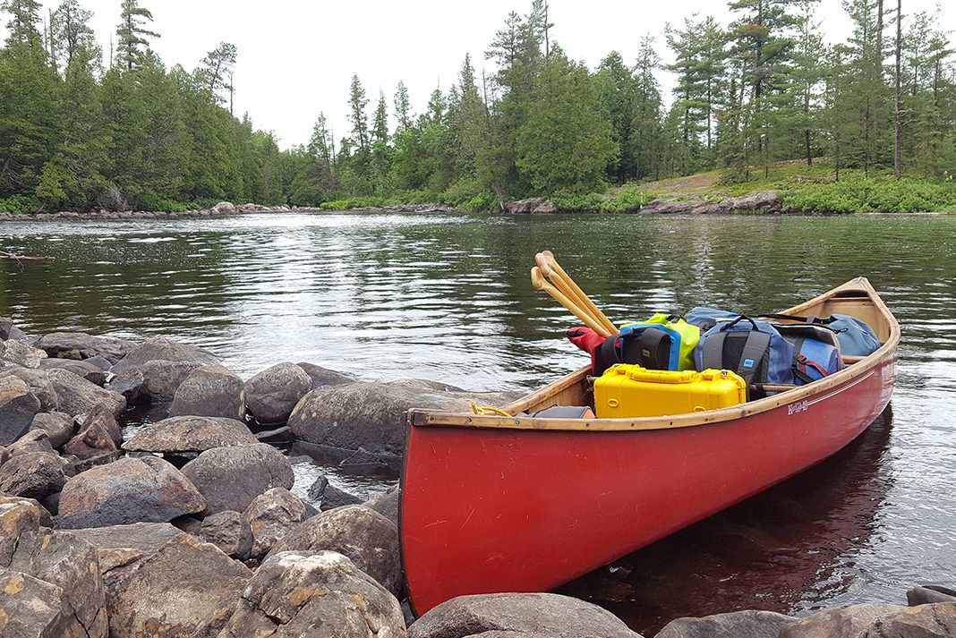 Kevlar canoe packed with camping gear