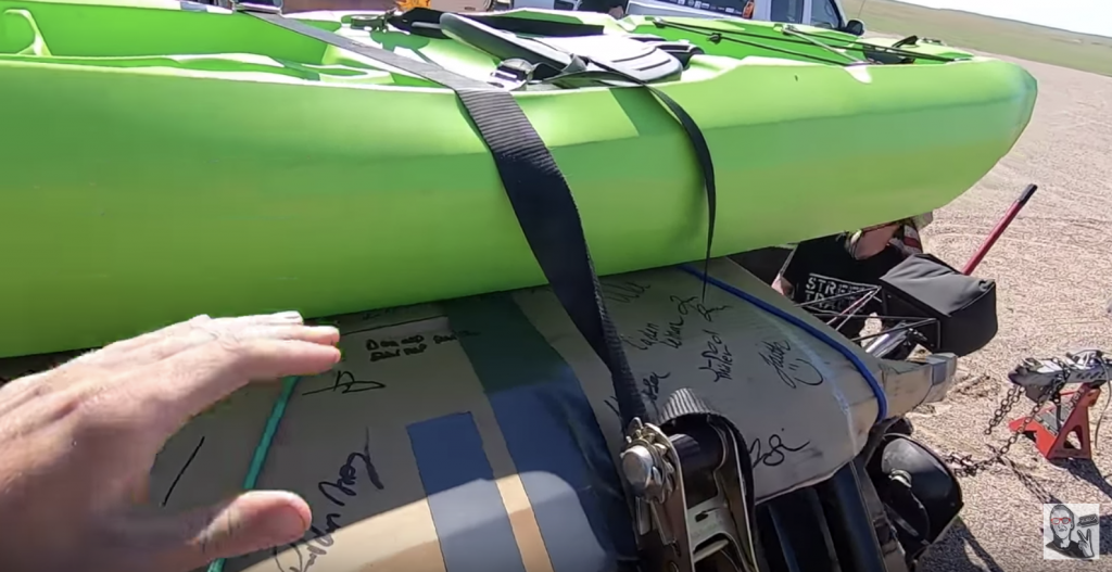 Kayak strapped to race car
