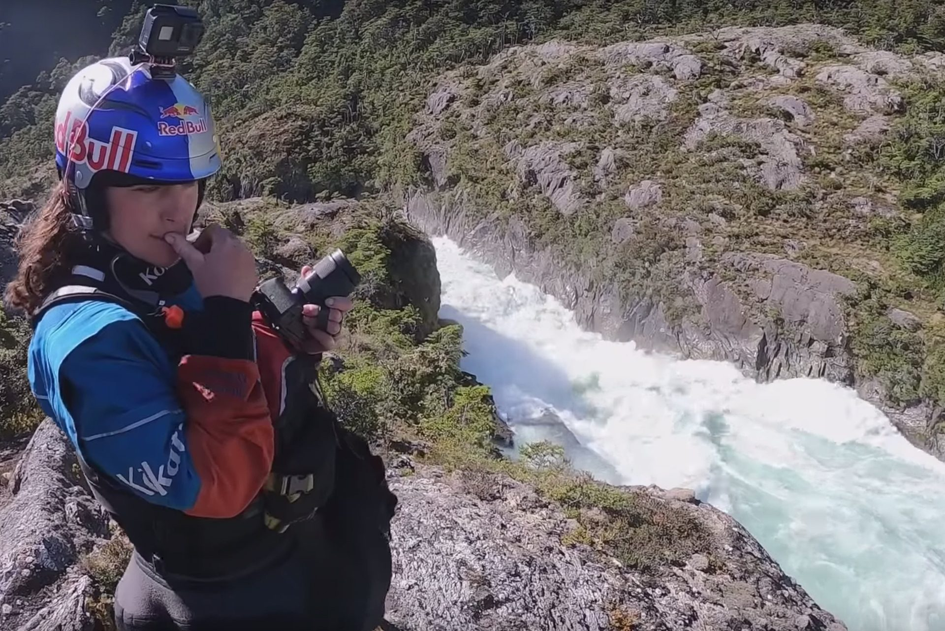 Nouria Newman scouts a rapid in Patagonia