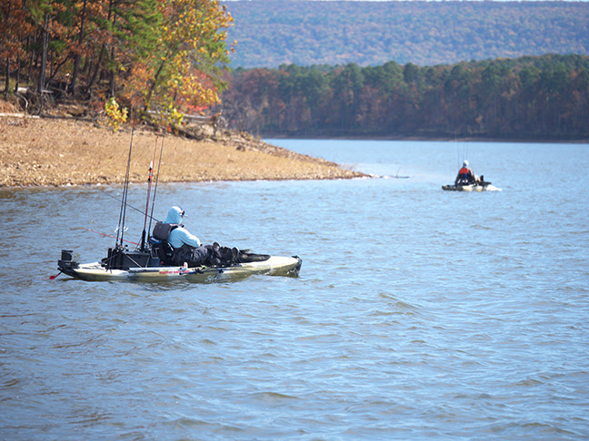 Kayak anglers faced the cold in spite of the bluebird skies on the picturesque competitive background Lake Ouachita.