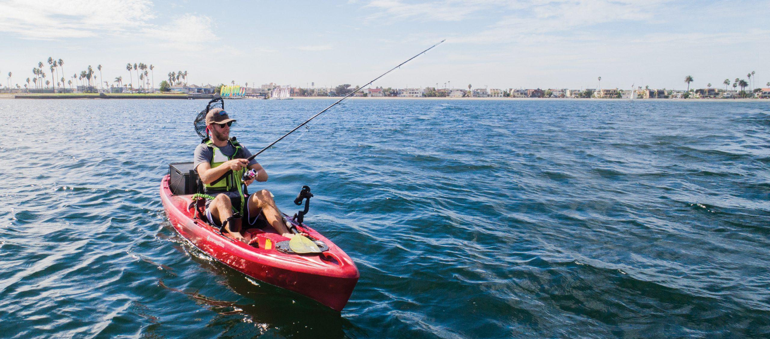 Man fishing out of red sit-on-top fishing kayak
