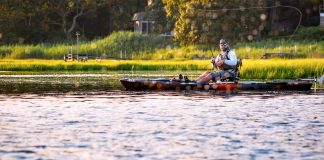 Person on sit-on-top fishing kayak with rod