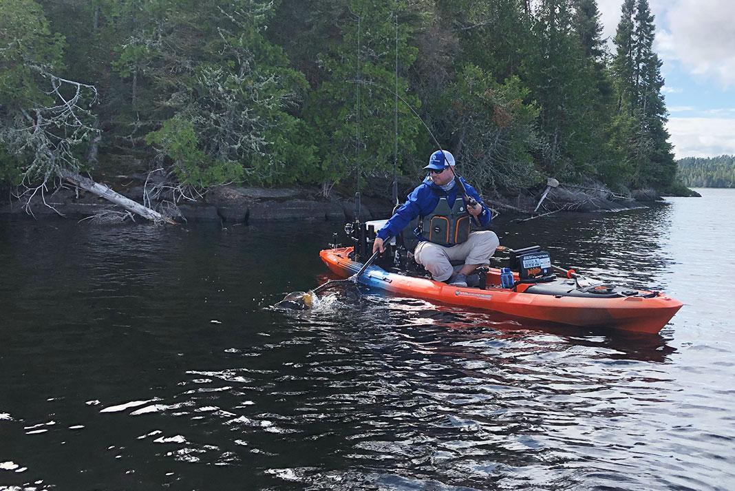 A kayak angler fishes a smallmouth bass hot spot