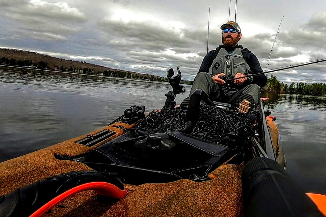 View from front of kayak of man fishing