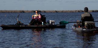 Two people on sit-on-top inshore fishing kayaks