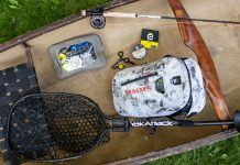 Backcountry fly fishing gear arranged in a canoe