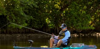 A kayak angler fishes with an Old Town Sportsman Autopilot kayak
