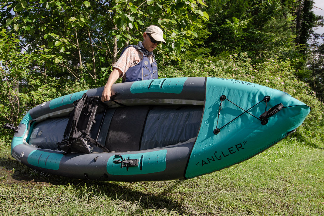 Fisherman carries inflatable AIRE IK angler