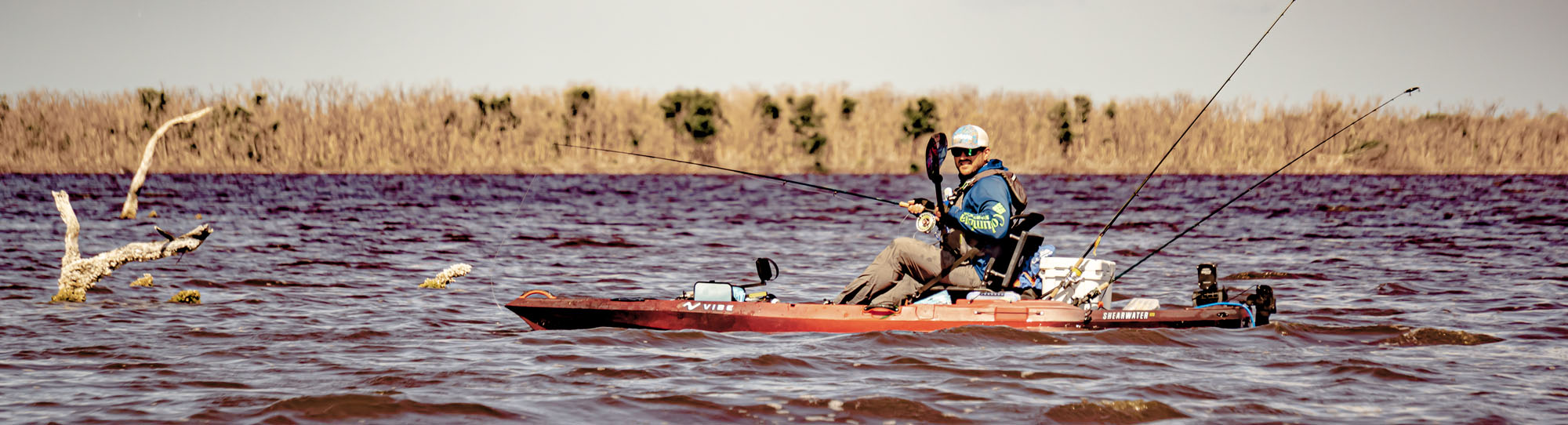 Man paddling saltwater fishing kayak
