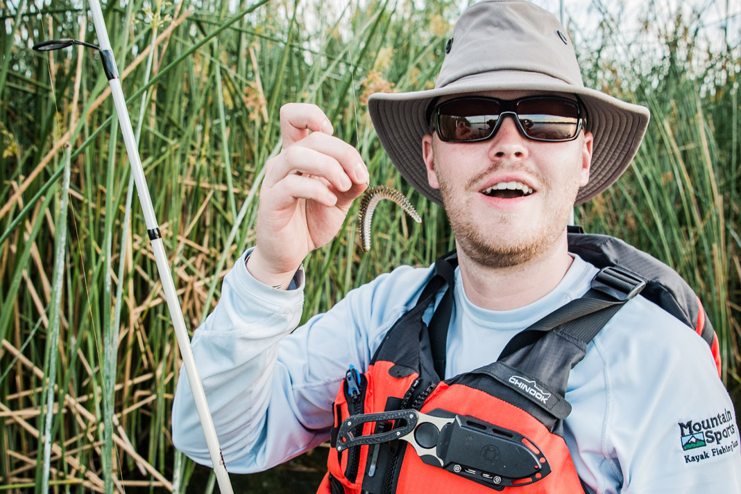 angler holds up a finesse rig for bass fishing