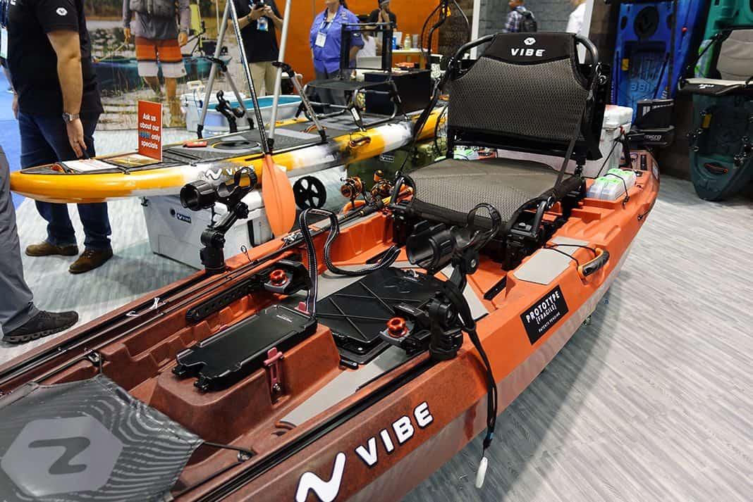 Orange fishing kayak in a showroom