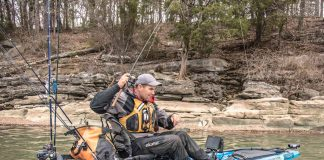 Angler fights a fish from kayak
