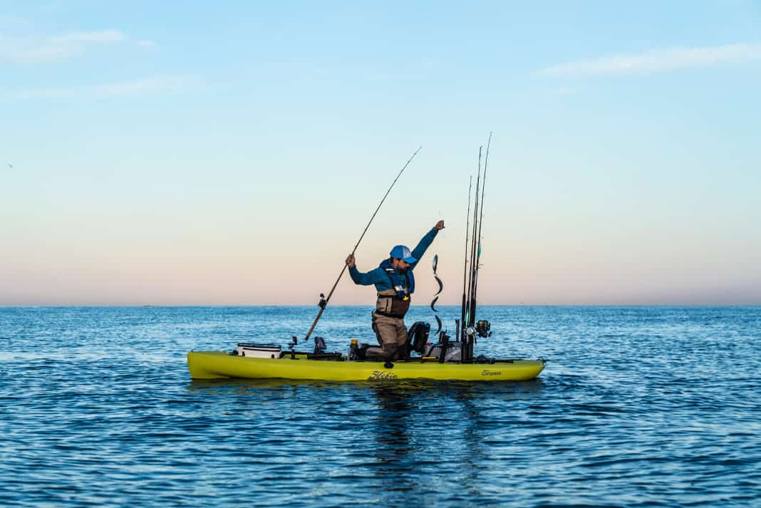 kayak angler prepares to fish for California yellowtail by trolling with live bait