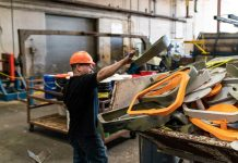 man re-using plastic for new kayaks