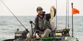 Mike McKinstry kayak fishing for bass on Lake St. Clair, Michigan