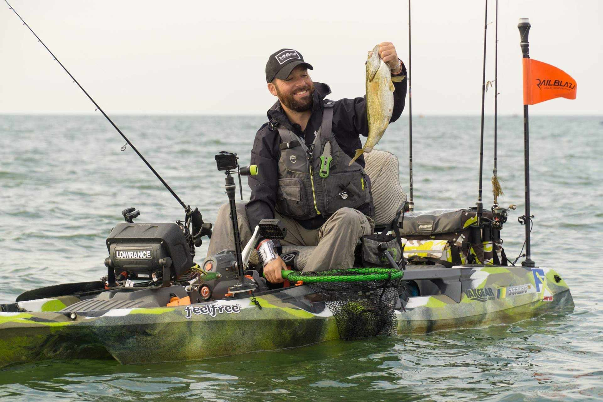 kayak angler holds bass on lake st. clair michigan