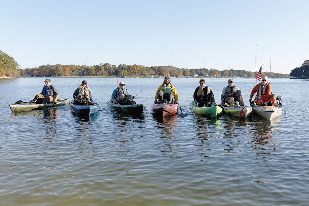 Anglers all lined up in different pedal powered kayaks