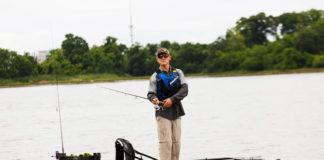 Man standing fishing in a Jackson Liska fishing kayak