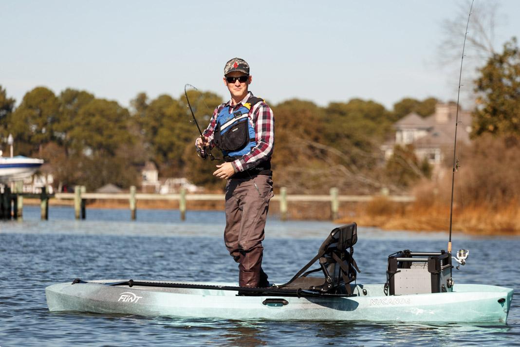 Man standing and fishing from the NuCanoe Flint hybrid fishing kayak