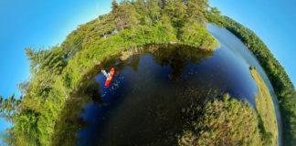 extreme fisheye lens photo of compact fishing kayak on a waterway