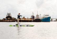 Man paddles the Kaku Voodoo hybrid paddlecraft like a SUP