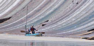 kayak fisherman fishing for bass