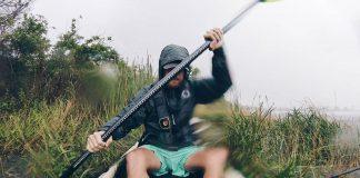 man paddles a fishing kayak with a perfect size paddle