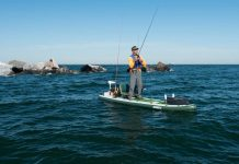 Dan Dejkunchorn fishes from a paddleboard, one of the experts providing SUP fishing tips