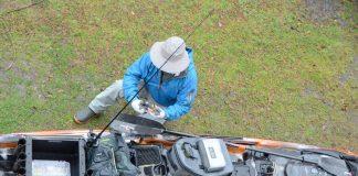 angler preparing his fishing kayak with rain-proof gear