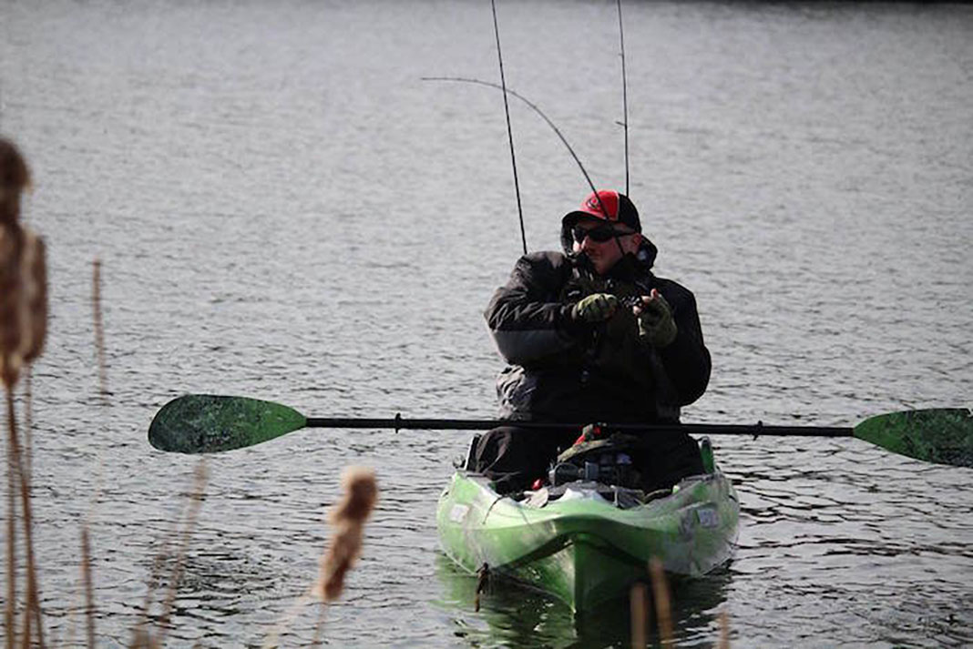 man fishes with mental toughness under difficult bass fishing conditions