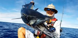 Raf Vargas displays his personal best wahoo catch while kayak fishing in Guam