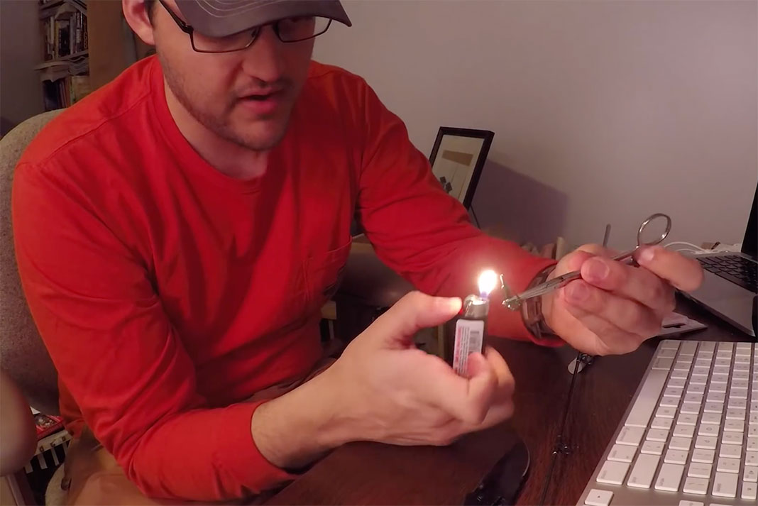 Ben Duchesney heats up a broken fishing rod tip he is fixing