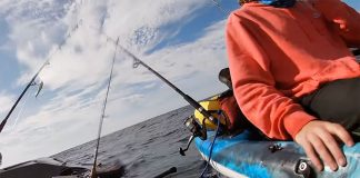 A man grabs for a handhold after his sinking kayak overturns 3 miles offshore
