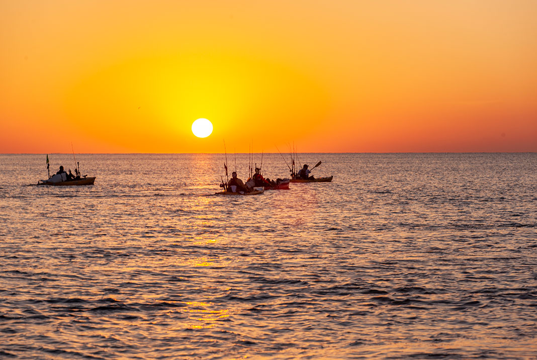 Kayaks at sunset in the Bahamas, one of Google's 10 most popular fishing destinations